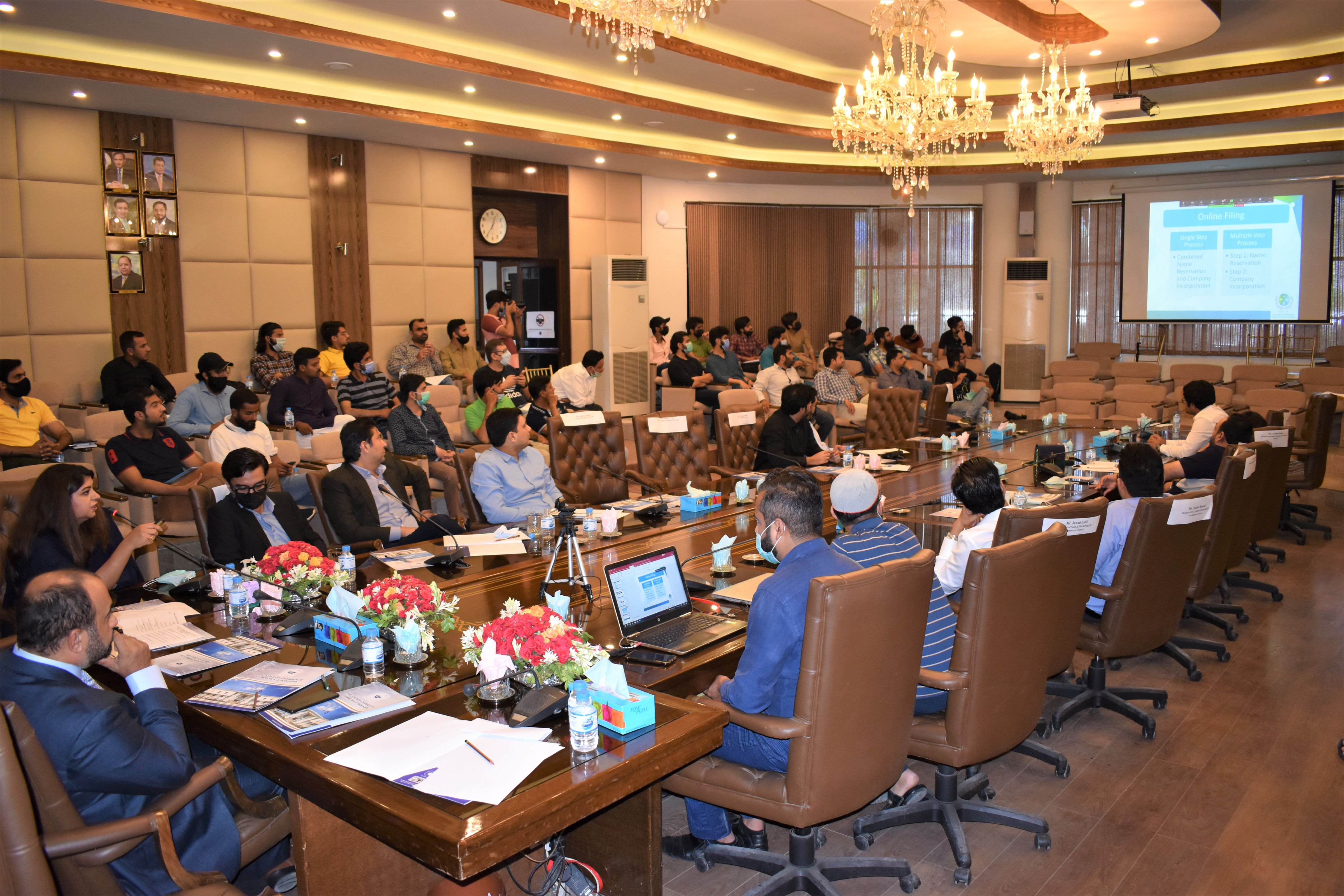 """On July 13, 2021, Sialkot Chamber of Commerce & Industry in collaboration with E-Commerce Galaxy organized an intensive Seminar on """"E-Commerce, Amazon, Payoneer, and usage of SEO Tools"""" to educate the existing as well as new exporters of Industry of Sialkot regarding the dynamics of selling their products on E-Commerce platforms mainly Amazon, Ebay. Mr. Qaisar Iqbal Baryar appreciated the efforts of Ms. Aisha Moriani and her team for working in getting Made in Sialkot products recognized on Amazon. An (MOU) was also signed between SCCI and E-commerce Galaxy for future collaborations. Mr. Khuram Aslam, Senior Vice President, SCCI also graced the event. Ms. Azka Ameen, Assitant Registrar SECP gave an introductory presentation regarding company incorporation with SECP using online portal. Team E-commerce Galaxy gave a detailed presentation on various aspects of working on Amazon for SME.  Ms. Affaf Noor, Partnerships Manager Payoneer explained the audience about the payment gateway and integration with various ecommerce and freelancing platforms.  Ms Ayesha Moriani, Senior Joint Secretary, Ministry of Commerce, Dr Shahzad Yousaf, City of London College, Mr. Urfan Yaqub, Co Founder & Director E-Commerce Galaxy and his whole team, Mr. Kumail Nadeem, Deputy Registrar SECP. Mr. Mohsin Muzafar, Country Head Payoneer & his team and Mr. Hassan Shah, Cordinator Ministry of Commerce's Think Tank on Amazon and representatives from Punjab Information Technology Board (PITB) briefed the audience  regarding various dynamics of E-Commerce and Issues faced by sellers during account creation and product listing were also discussed and relevant solutions were advised through Q/A session. The Seminar was broadcasted live on Facebook and Zoom apart from being arranged at the Sialkot Chamber."""