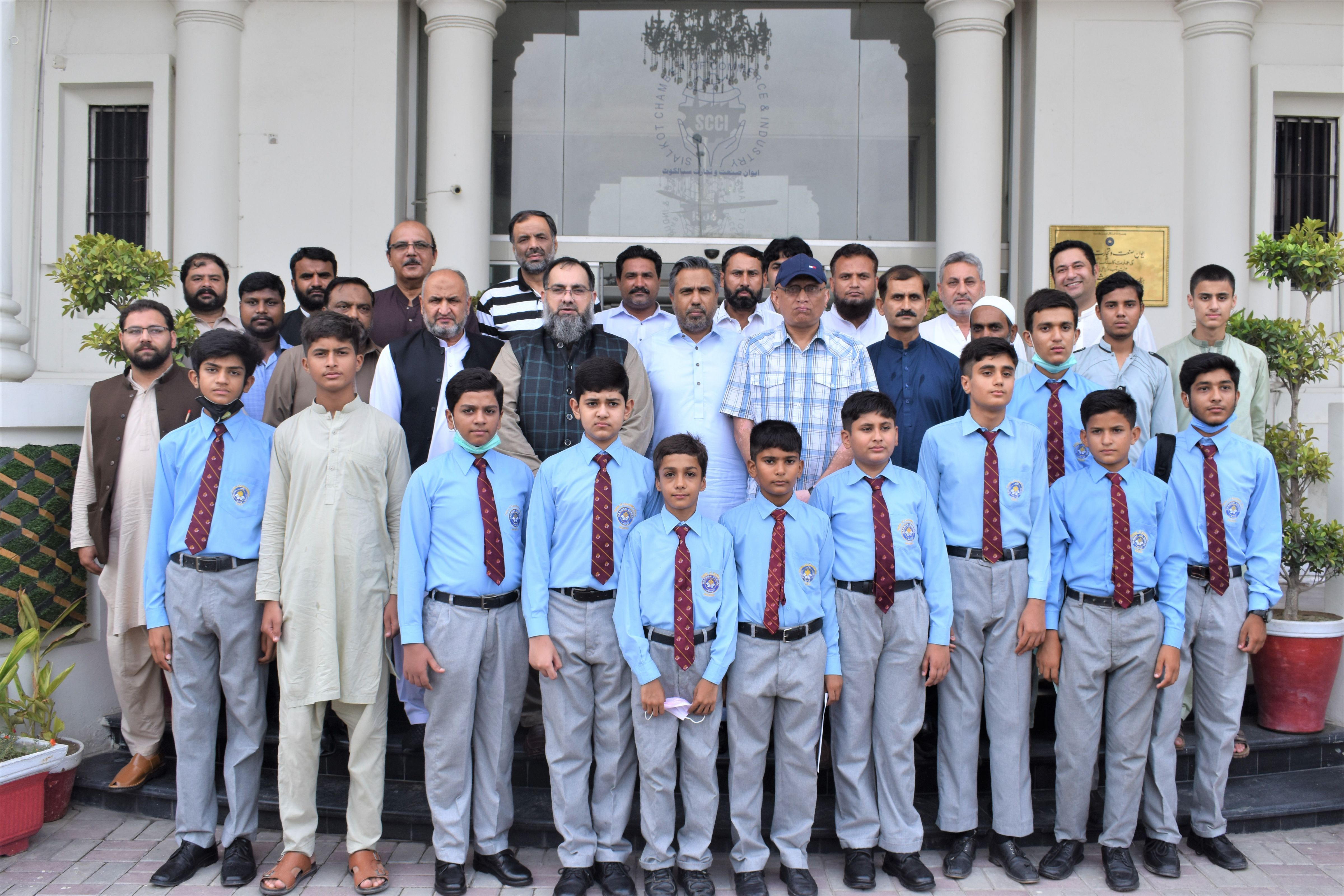 """On July 16, 2021, Mr. Qaisar Iqbal Baryar, President, SCCI presided over """"Annual Prize Distribution Ceremony of Toppers, Session 2021 from Govt. Pilot Secondary School, Centre of Excellence (Boys), Sialkot"""" held at Sialkot Chamber of Commerce & Industry. Mr. Qaisar Iqbal Baryar and Mr. Khuram Aslam, Senior Vice President, SCCI distributed the Prizes among the students and congratulated all the prize-winners for their achievement"""