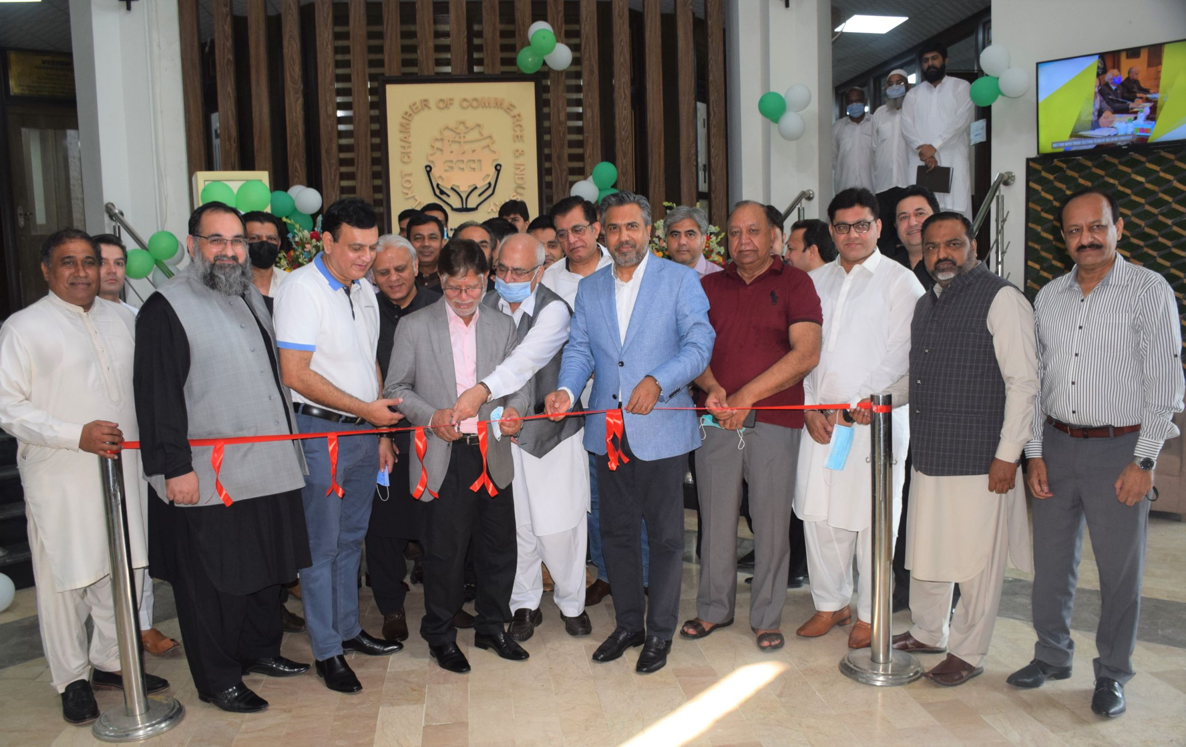 """On August 30, 2021, an inauguration ceremony of """"Establishment of Membership Department, Conference room for online meetings and Dining Hall"""" was held at Sialkot Chamber of Commerce & Industry. The Program commenced with the ribbon cutting by Mr. Sheikh Riaz ud Din, Mr. Qaisar Iqbal Baryar, President, Mr. Khuram Aslam, Senior Vice President, Mr. Ansar Aziz Puri, Vice President, Former Presidents and Members of Executive Committee, SCCI.   President, SCCI thanked all the guests for gracing the occasion by their presence and said that the news departments would help in providing best services to the members."""