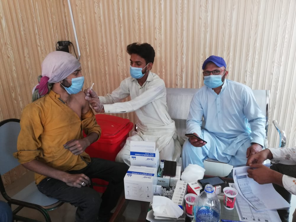 HealthCare Workers working under SCCI Covid-19 Vaccination Drive vaccinating Laborers of a local Industry adhering to COVID-19 SOPs.